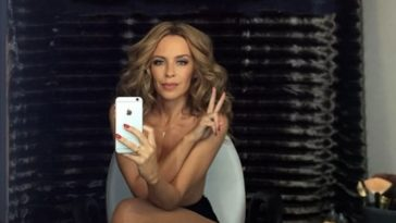Topless Kylie Minogue Covering Up Her MILF Tits 13