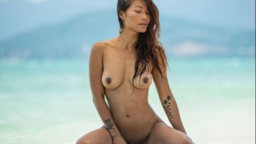 Naked Maki Katana Strikes Sexy Poses on the Beach 13